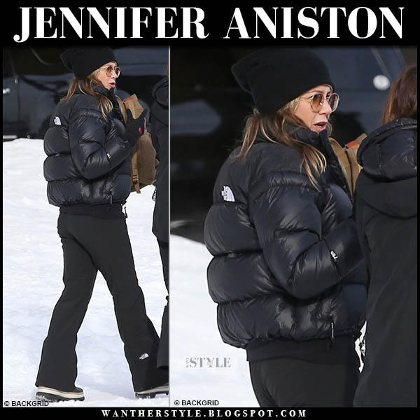 Jennifer Aniston in black puffer jacket and black ski pants north face winter snow fashion