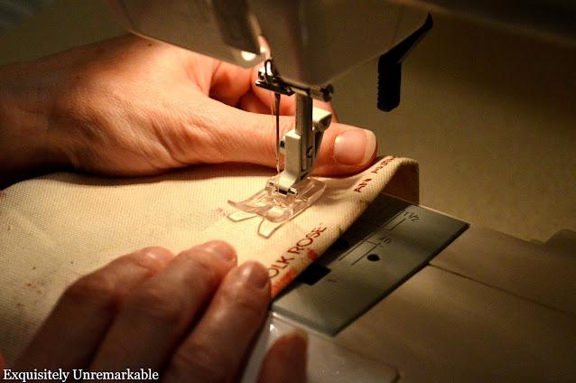 Running fabric through the sewing machine