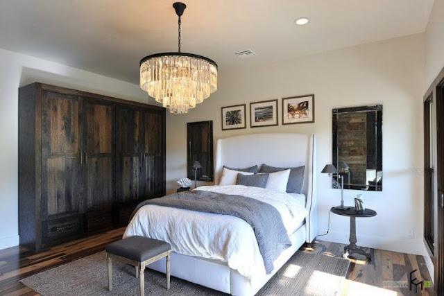 Hardwood Floor Bedroom With Crystal Chandelier