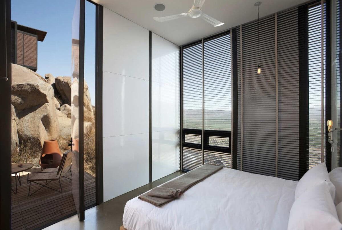 03-Bedroom-Entrance-Gracia-Studio-Cabin-Architecture-set-on-a-Hill-www-designstack-co
