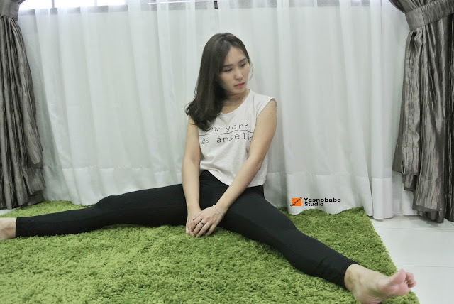 Stepheny Siew stretching her legs in her jonlivia compress pants