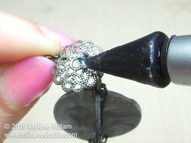 Attaching the flat back crystal to the bead cap.
