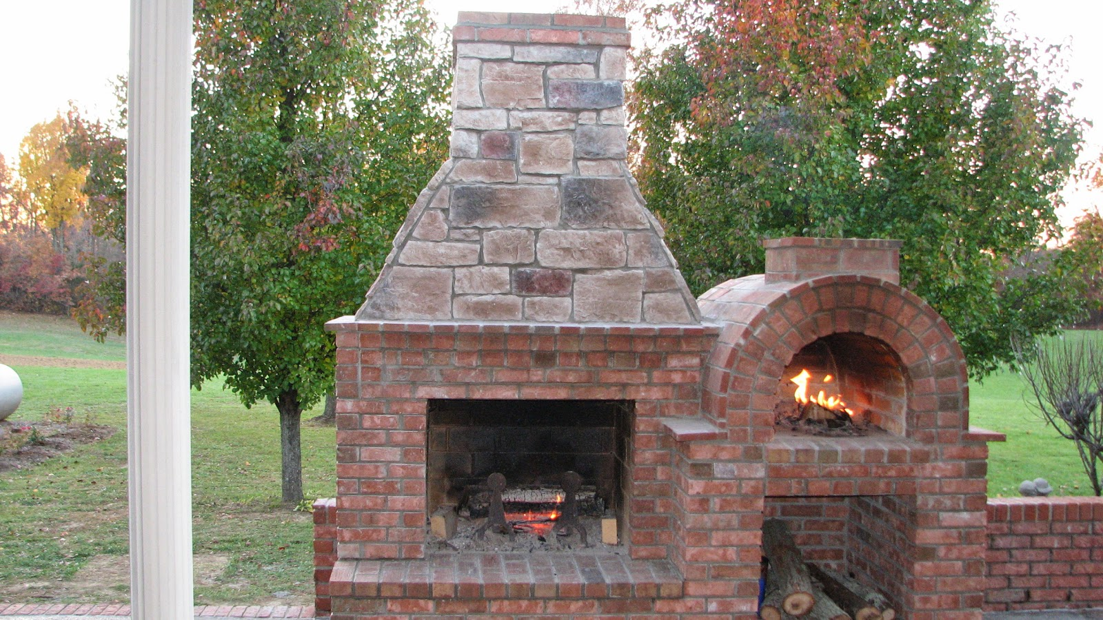 Custom outdoor fireplace and pizza oven with an outdoor ...