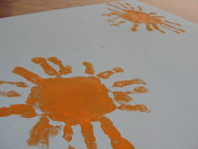 child's handprint sun