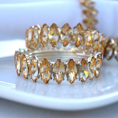 https://www.etsy.com/listing/535824089/rhinestone-napkin-rings-vintage-set-of-4?ref=shop_home_active_23
