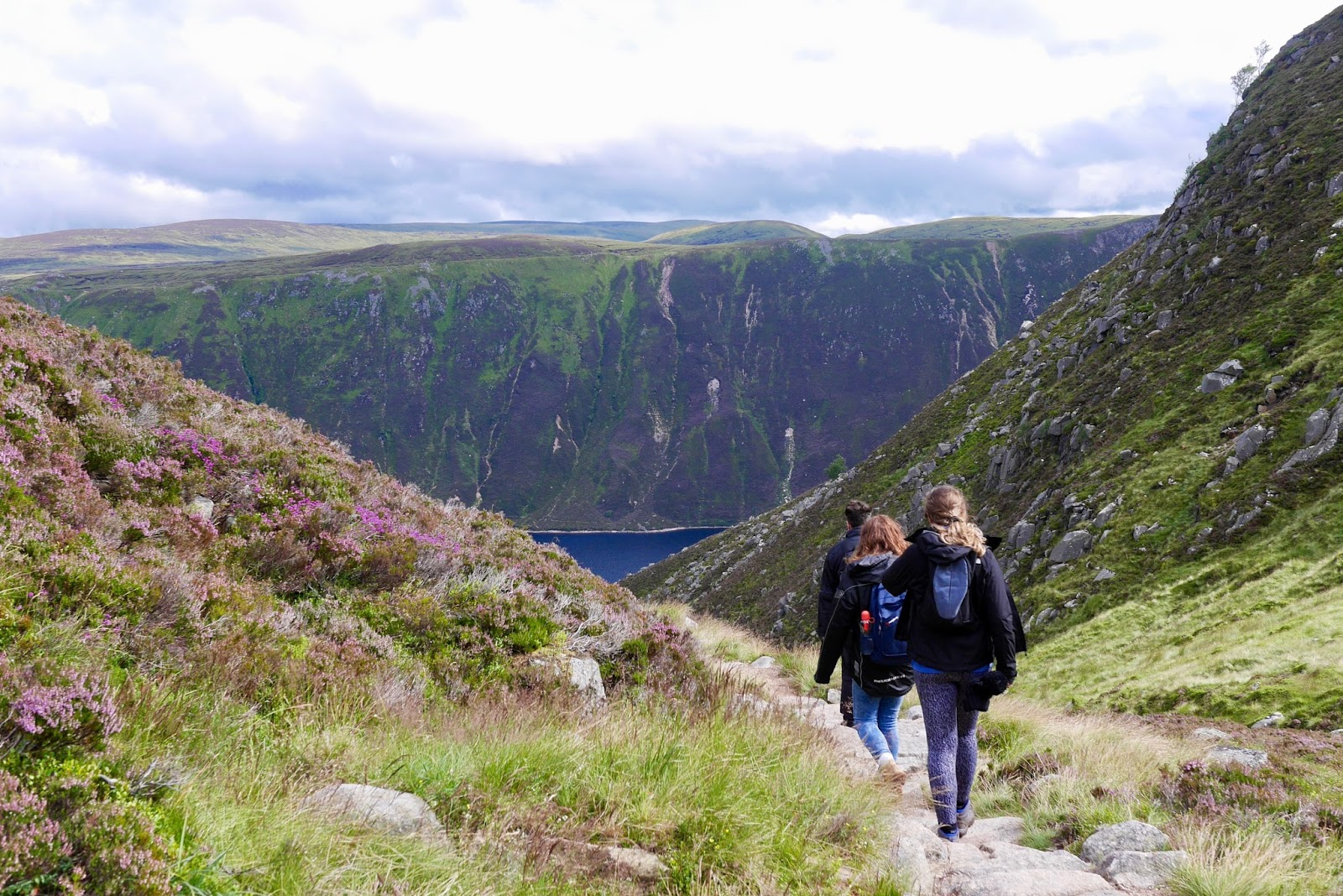 group hiking the Scottish mountains, Lochnagar Munro - Cal McTravel - www.calmctravels.com