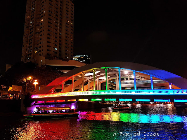 Bridge lit up at night with rainbow lights