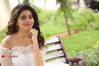 Actress Tejaswini Pictures in White Dress at Lachhi Teaser Launch  0293.JPG