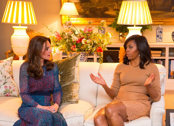 Prince William, Duke of Cambridge speaks with US President Barack Obama as Catherine, Duchess of Cambridge speaks with First Lady of the United States Michelle Obama and Prince Harry in the Drawing Room of Apartment 1A Kensington Palace