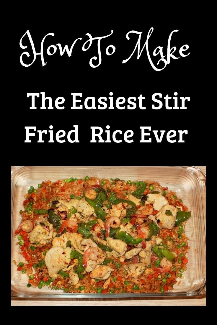 This is How to make stir fried rice with chicken and shrimp.. Asian style rice with peas and carrots with scrambled eggs in a frying pan
