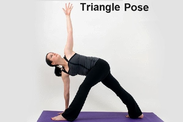 an Asian woman doing triangle pose