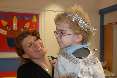 picture of steph smiling at daisy who is dressed as an angel with tinsel in her hair