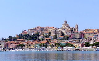 The waterfront of the Ligurian port city of Imperia, with the Basilica of San Maurizio on top of the hill