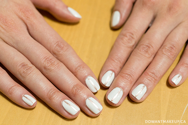 Rose gold stripe nail art on white