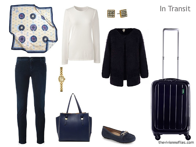 cool-weather travel outfit in navy and ivory