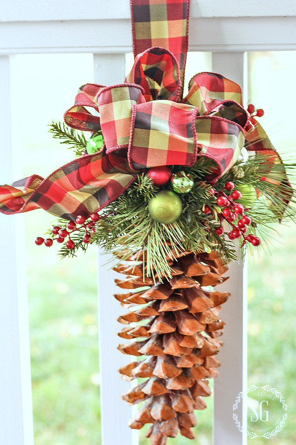 a big pine cone is turned into a Christmas ornament