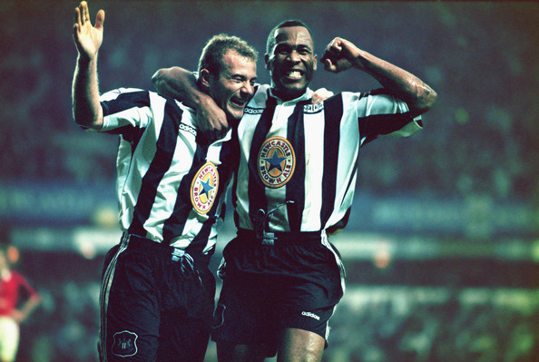 Newcastle strikers Alan Shearer (l) and Les Ferdinand celebrate a goal during the Premiership match between Newcastle United and Manchester United at St Jame's Park on October 20, 1996 in Newcastle, England