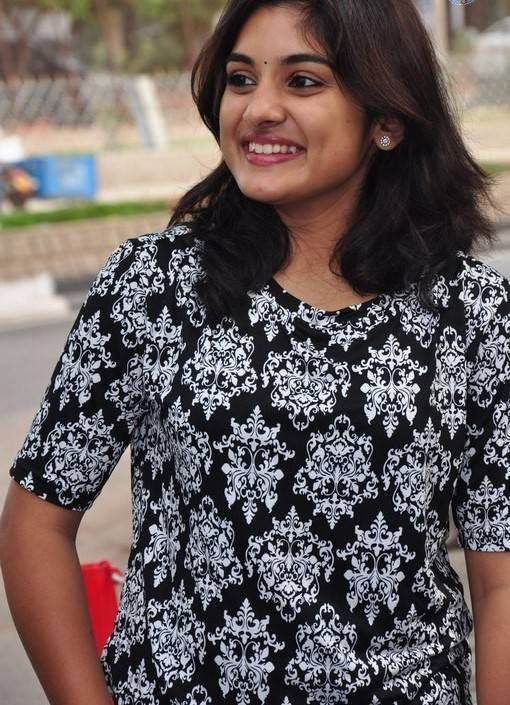 Niveda Thomas Photos In Black Dress