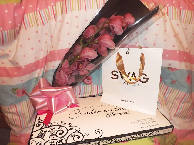 An orchid bouquet, chocolates and jewellery
