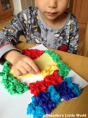 Child working on a tissue paper craft kit