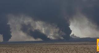 داعش الأرهابي  يحرق آبار النفط في مركز قضاء تلعفر للتشويش على الطيران العسكري العراقي و لكن تم القصف بنجاح !