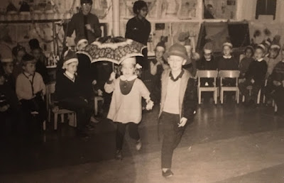 black and white photo of Corina Duyn and Frans Hogevorst dancing in a school party, aged 4. Movement is life