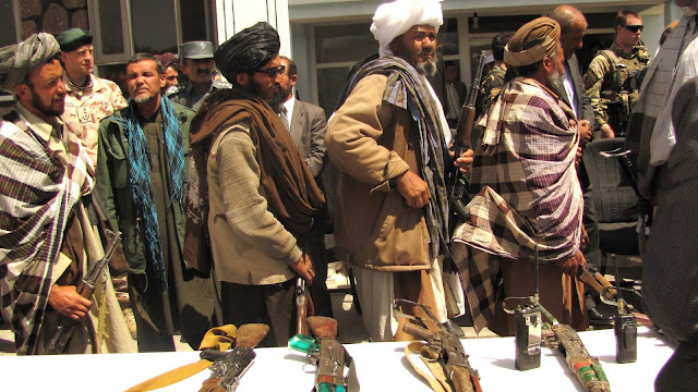 Image Source: Former Taliban fighters return arms / Source: Wikimedia Commons