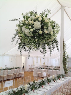 white wedding flowers in marquee, Suffolk