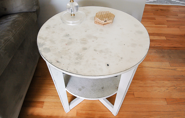 Stained and damaged side table sealed with wax