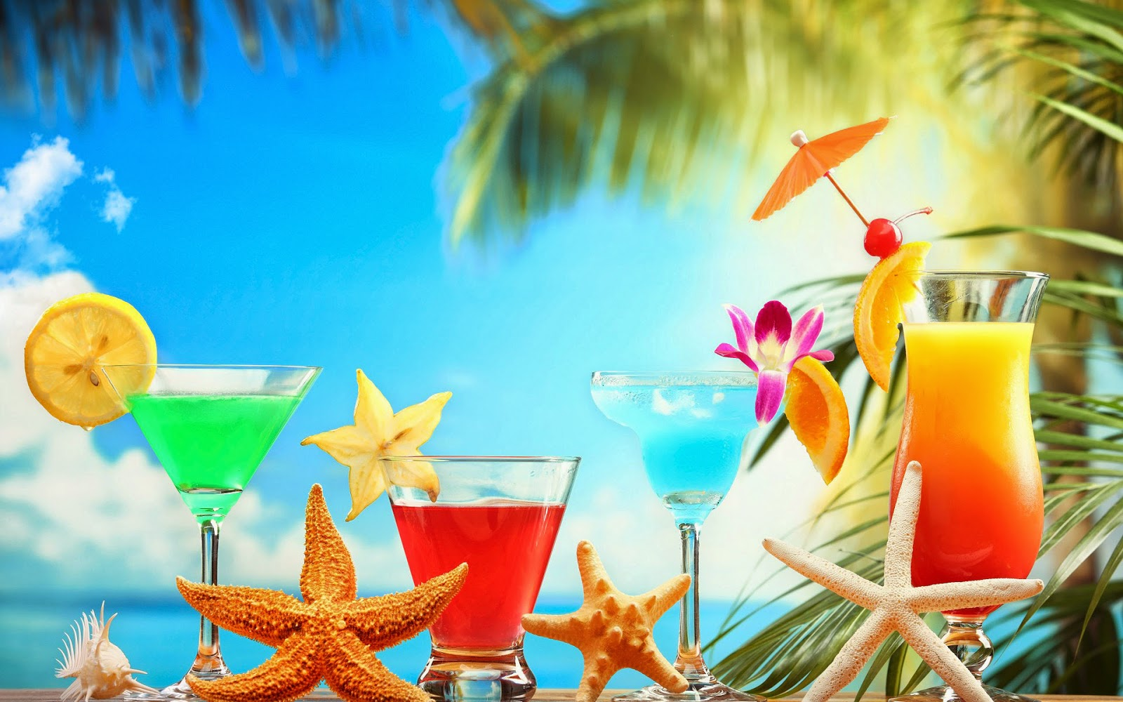 Foto met cocktail en zeesterren