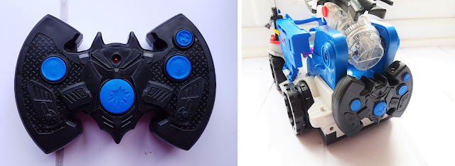 black batman logo looking remote control 4 blue buttons, remote control attachable to the back of the command centre
