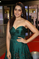 Raashi Khanna in Dark Green Sleeveless Strapless Deep neck Gown at 64th Jio Filmfare Awards South ~  Exclusive 131.JPG