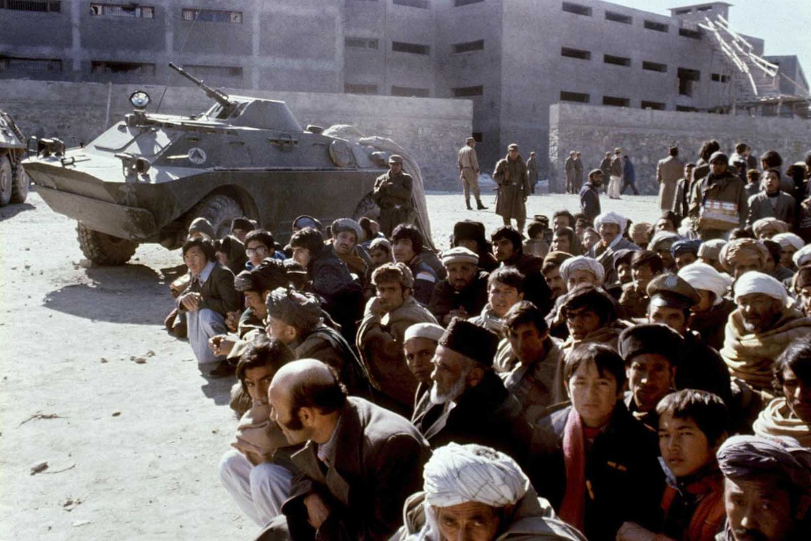 Afghans wait outside the Kabul central Pulicharkhi prison on January 14, 1980, days after the Moscow-installed regime of Babrak Karmal took over. Although the regime released 126 prisoners from the notorious jail, around 1,000 residents stormed the compound to set 12 inmates free.