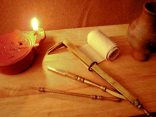 Medical instruments and bandage by the light of an oil lamp