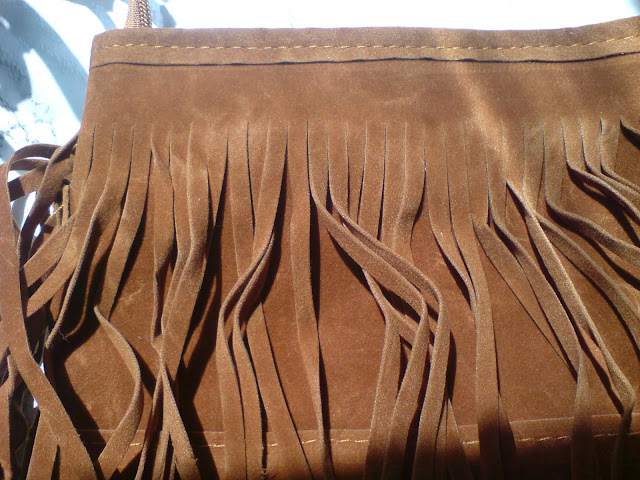 http://www.rosegal.com/crossbody-bags/fashion-fringe-and-weaving-design-79774.html?lkid=141324