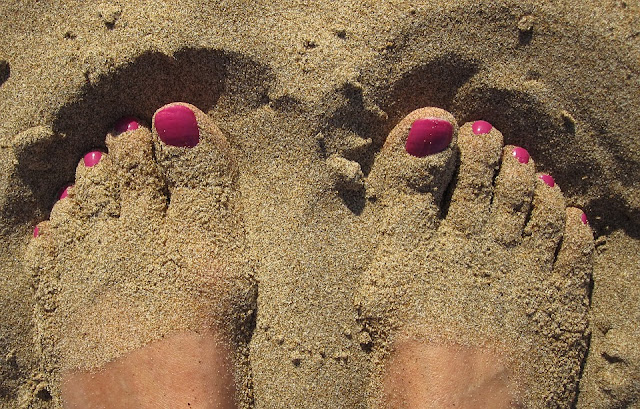 Polished Toe Nails in the Sand
