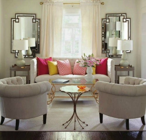 The Symmetry Of Mirrors And Tables On Either Side Couch Make Window Stand Out More Than It Would If Nothing Were Standing In Its Way