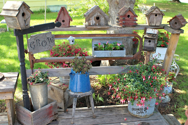 Rustic Birdhouses and Fuchsias To Decorate the Deck