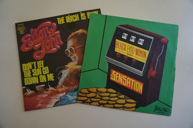 """The Sensation Black Eyed woman baby glam rock 70s 1970, Elton John """"The bitch is back"""" records"""