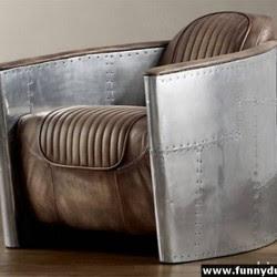 Diseño de sillón único metálico y piel