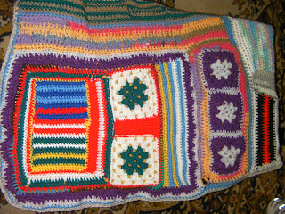 brightly coloured knitted cellular blanket