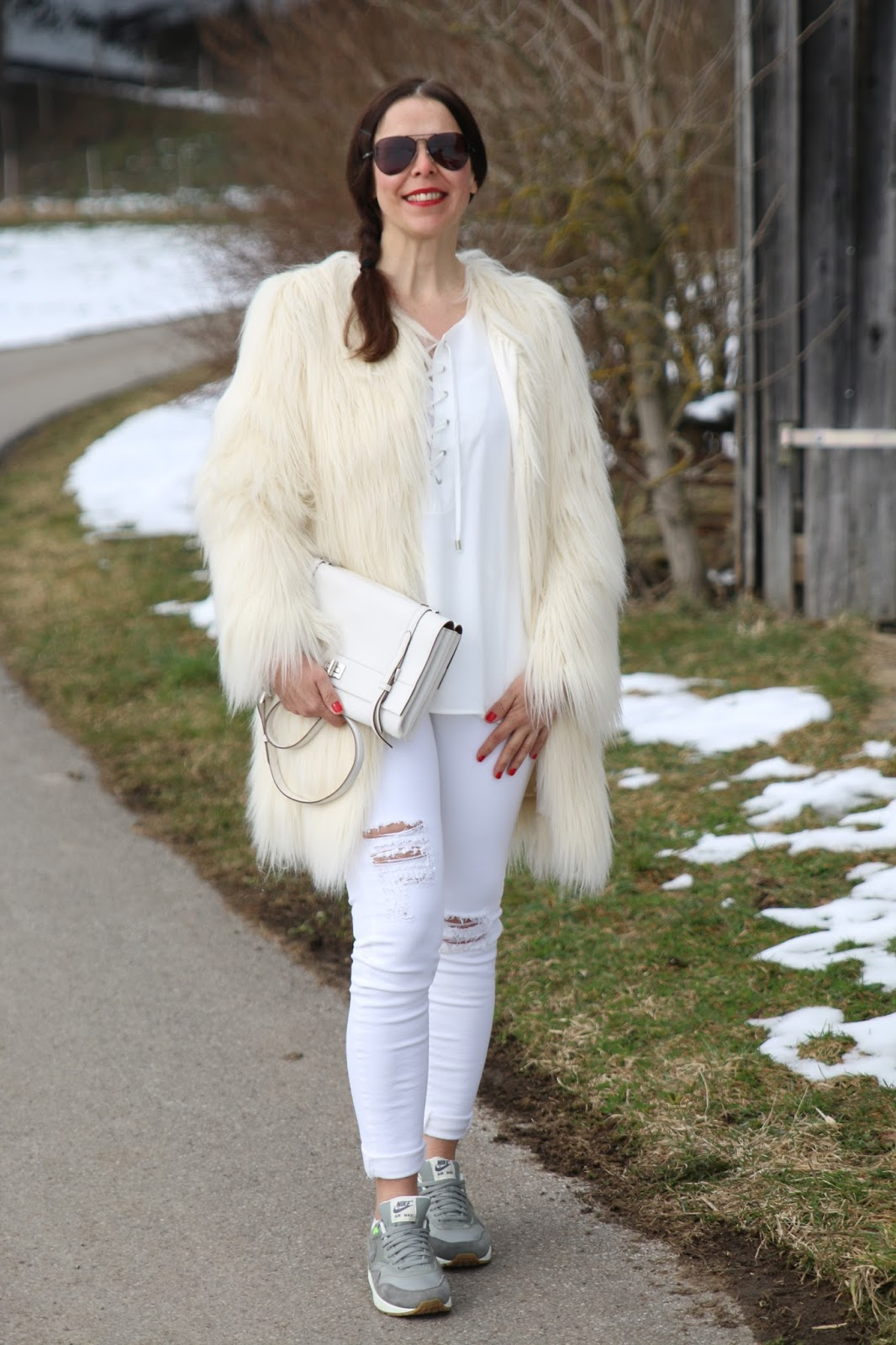 Outfit white fake fur jacket, white ripped denims, grey Nikes, white Prada bag