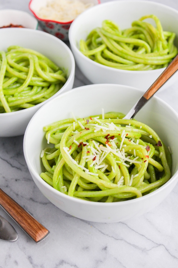 Looking for an easy dinner recipe? This Bucatini with Spinach Pesto is the best! Fresh pesto is tossed with hot cooked pasta for a simple yet flavor packed meal!