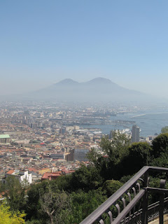 A hazy view of Mount Vesuvius across Naples from the top of Vomero Hill