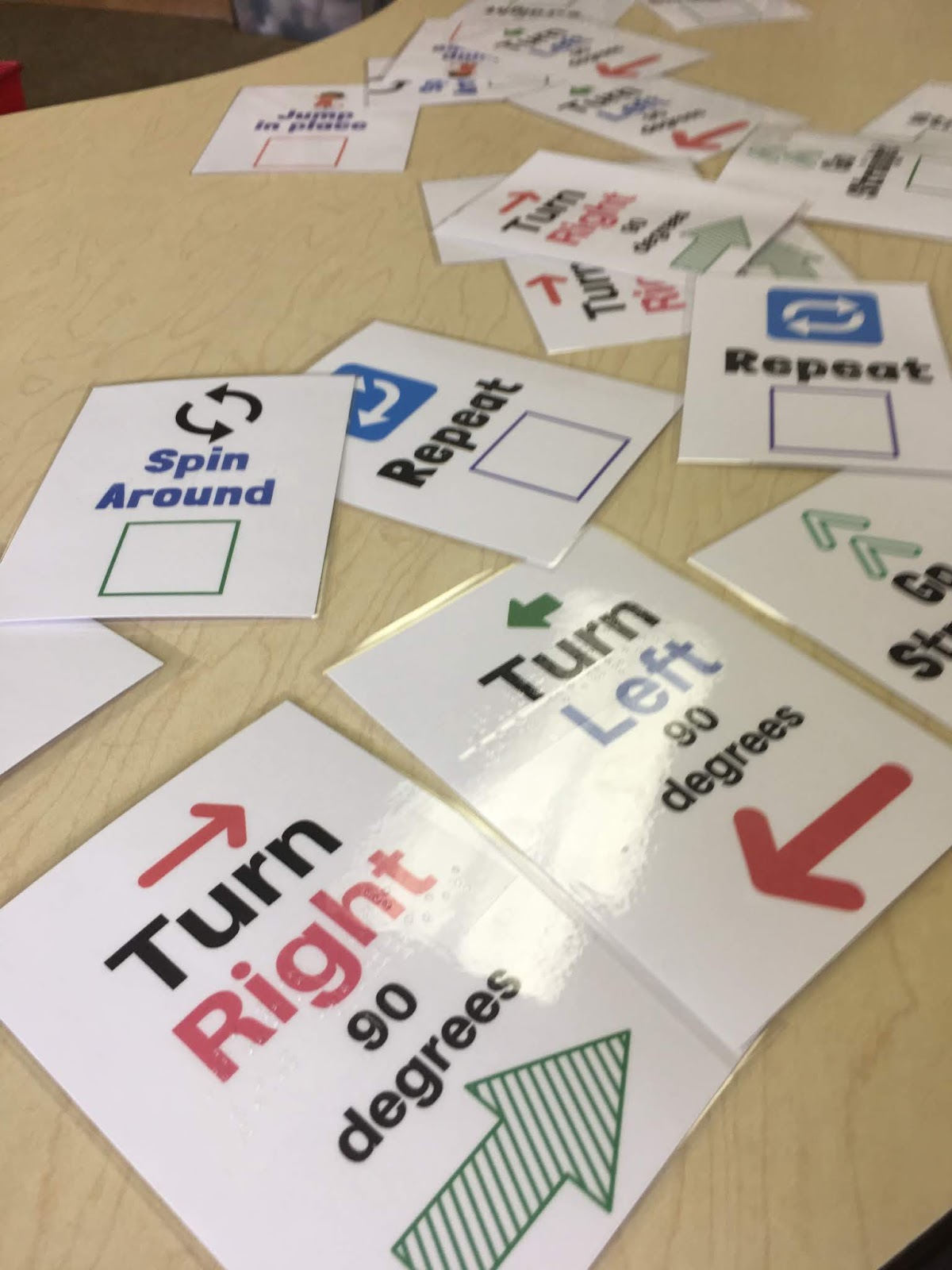 The offline coding cards are scattered on a table.