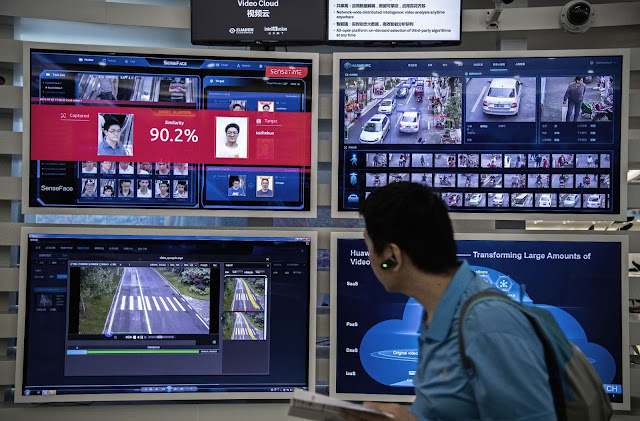 A display for facial recognition and artificial intelligence is seen on monitors