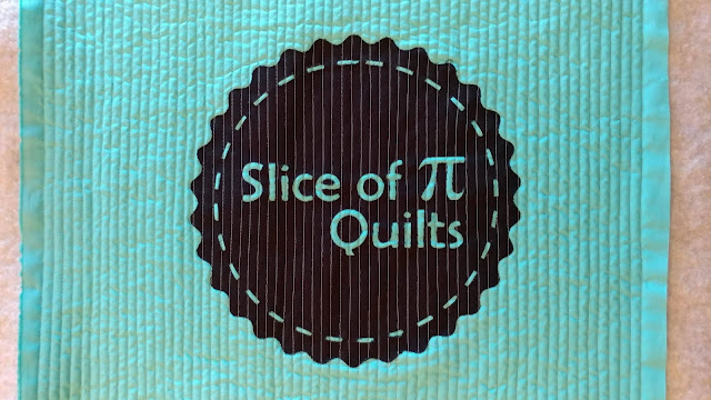 Quilted tote bag with Slice of Pi Quilts logo