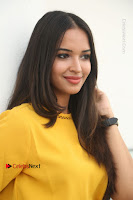 Actress Poojitha Stills in Yellow Short Dress at Darshakudu Movie Teaser Launch .COM 0158.JPG