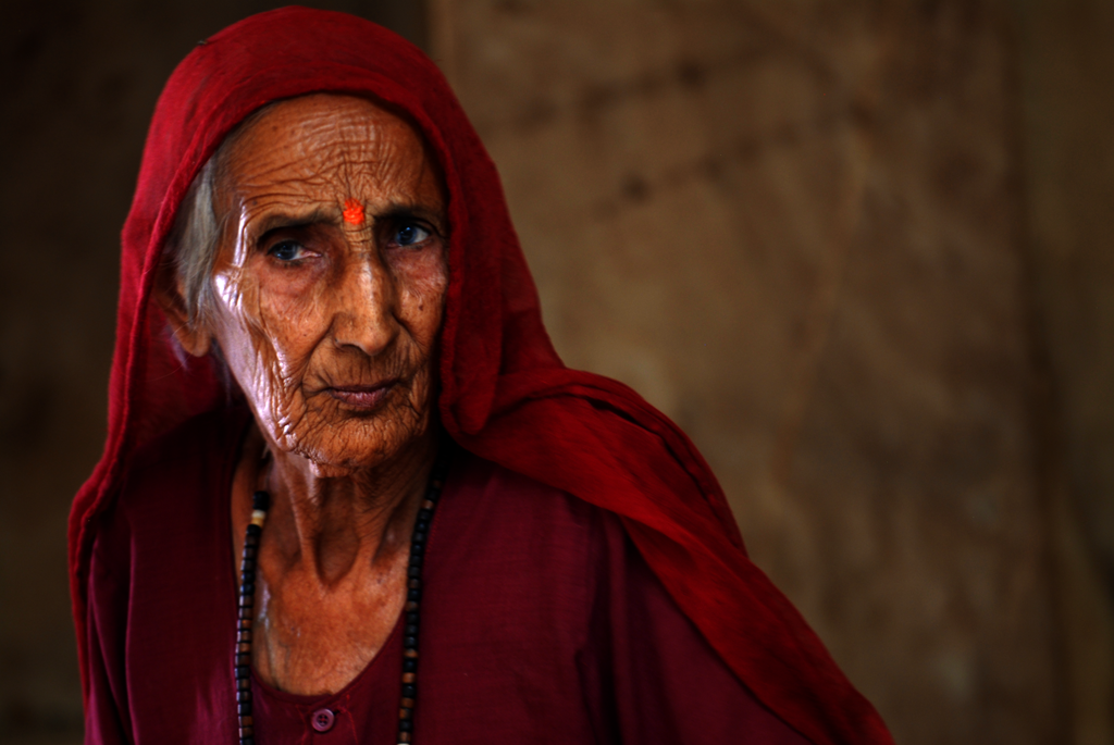 An elderly woman in the Karni Mata Temple in Deshnok, India.