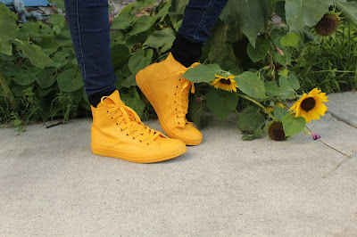 yellow converse rubber shoes